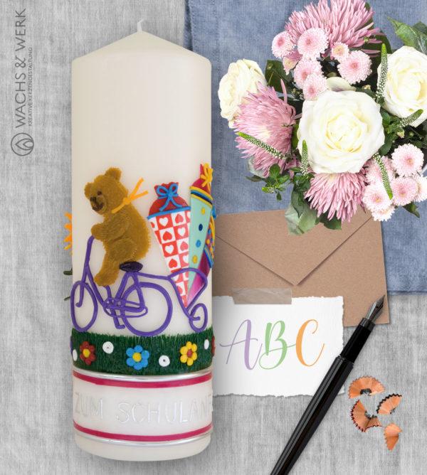 Kerze zum Schulanfang mit Teddy und Fahrrad